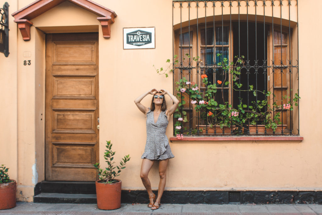 Woman posing by a colonial building in Santiago