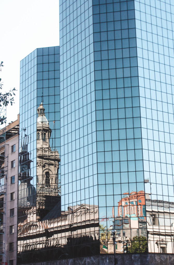 Reflection of the main cathedral on Plaza de Armas in Santiago Chile