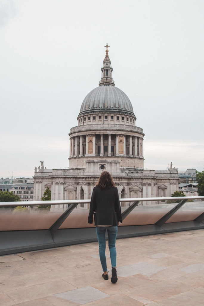 woman looking at st paul's cathedral in london