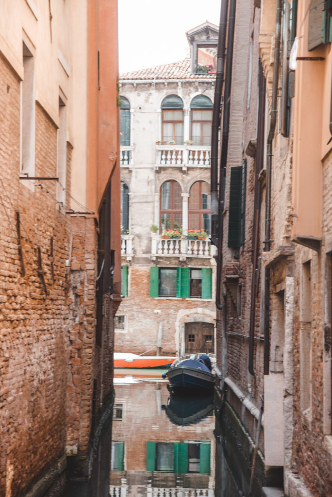 Red brick buildings on a canal in venice