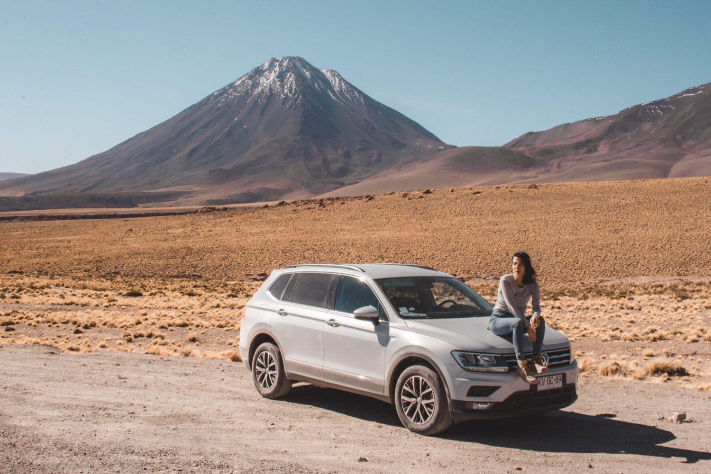 Woman on a car on Atacama Desert tours