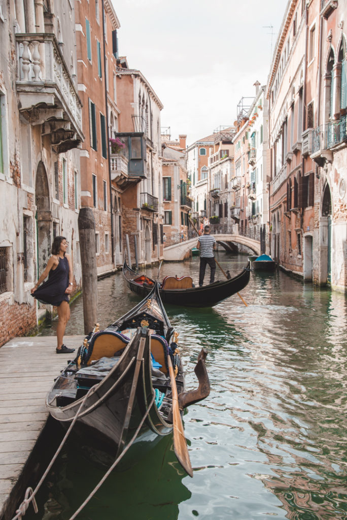 Woman standing by a canal in Venice.self care ideas pdf
