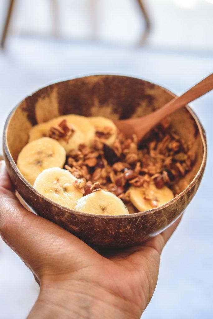 healthy granola recipe in coconut bowl
