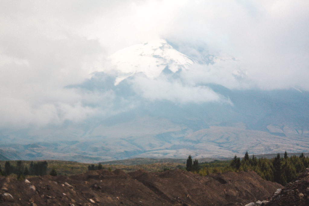 Cotopaxi National Park view of Cotopaxi volcano behind the cloud