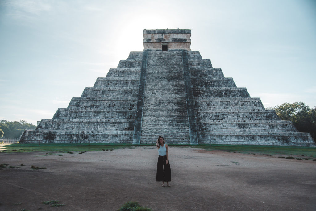 Chichen Itza main pyramid woman standing in front of