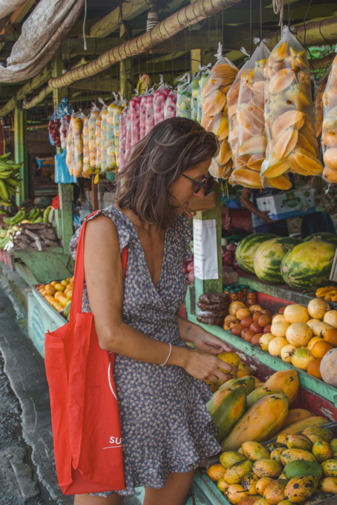 woman shopping in a tropical fruit market