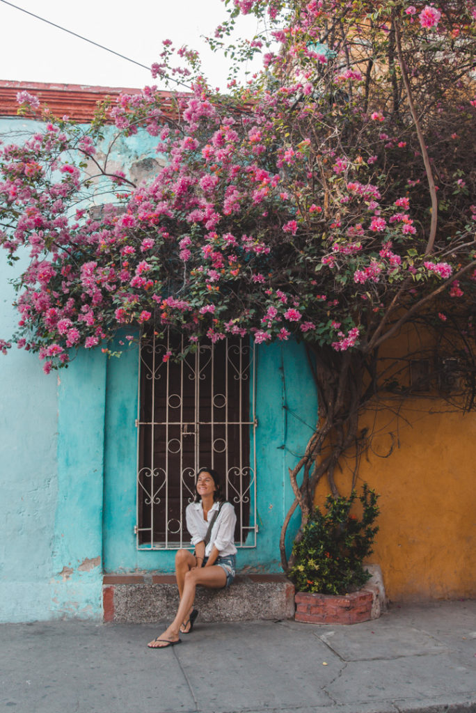 Girl sitting on the street in Getsemani Colombia