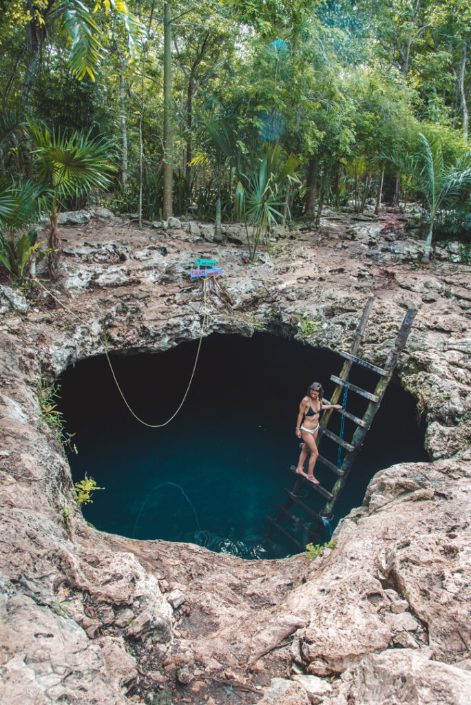 Cenote Calavera Mexico- standing on the exit ladder.
