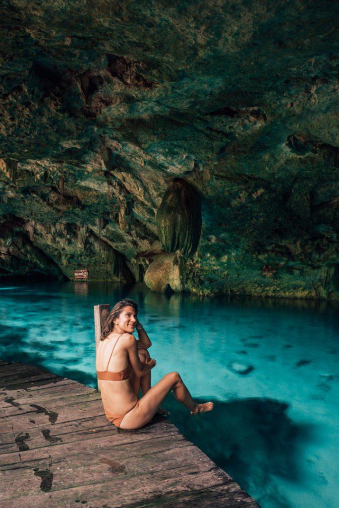 Sitting at Cenote Dos Ojos Tulum Mexico