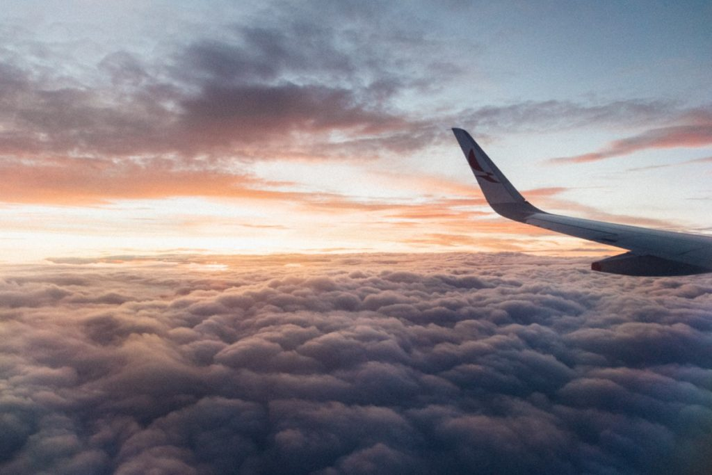 plane wing with a sunset in the sky