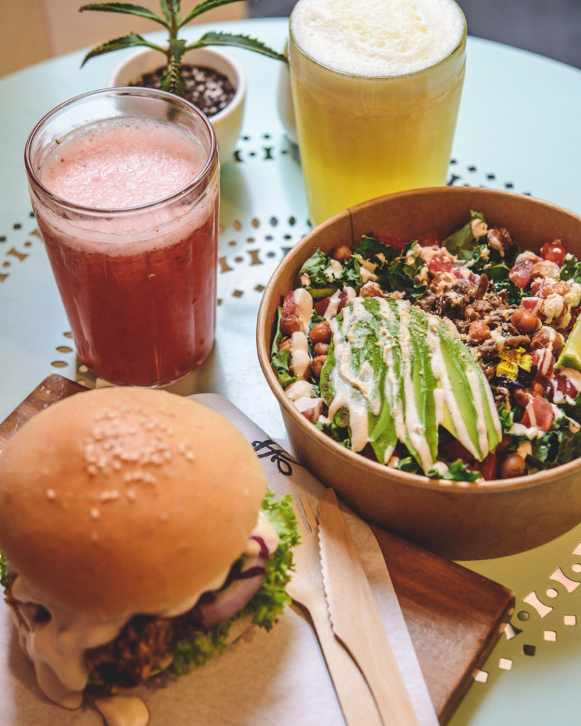 Healthy vegan burger and salad at vegan restaurant