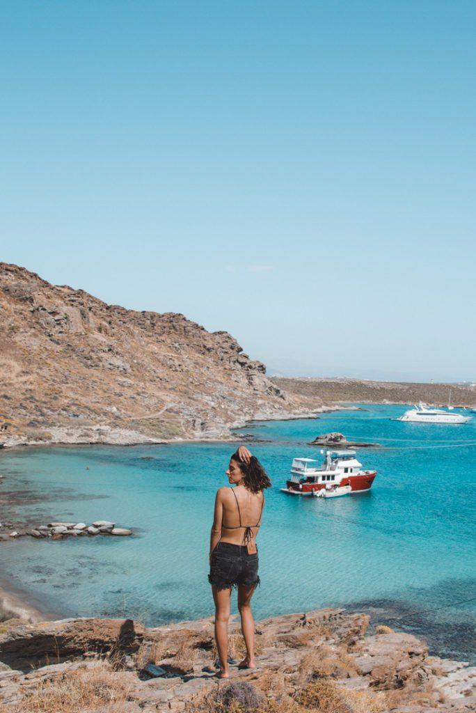 Woman standing over best beach in Paros