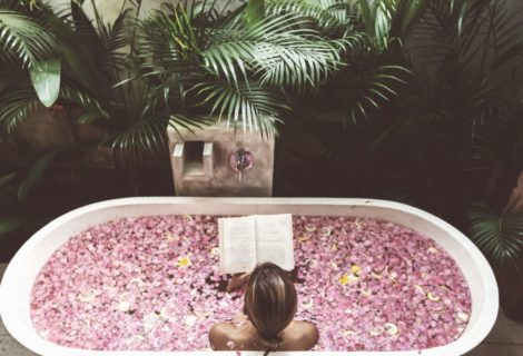 woman in a bath of pink flowers
