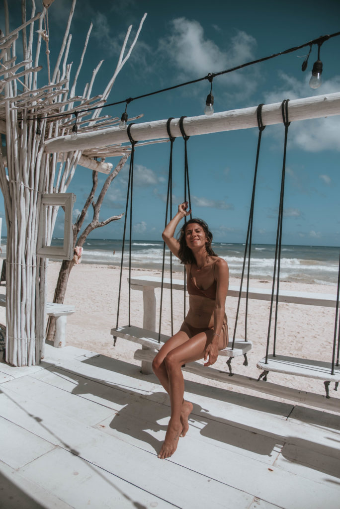 Tulum itinerary- woman on a beach swing
