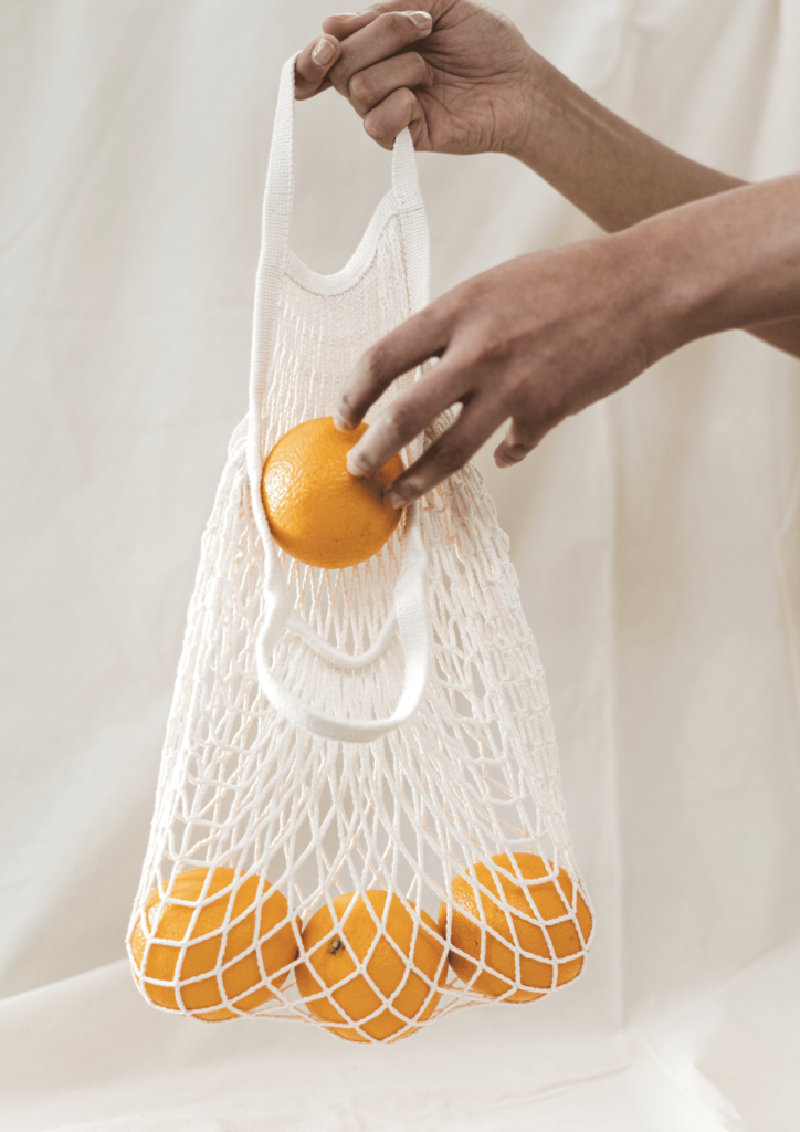 mesh grocery bag with oranges