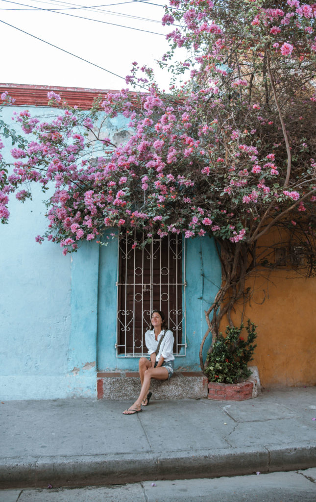 Woman sitting infront of colonial building Getsemani Cartagena
