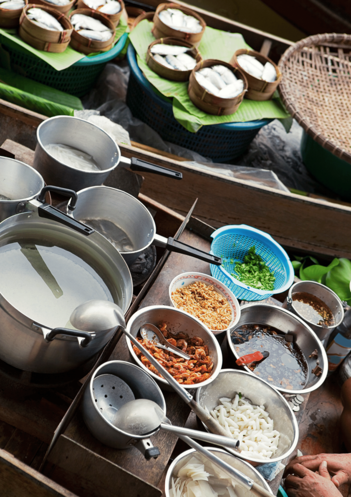 Cookware on a boat at floating market in Bangkok