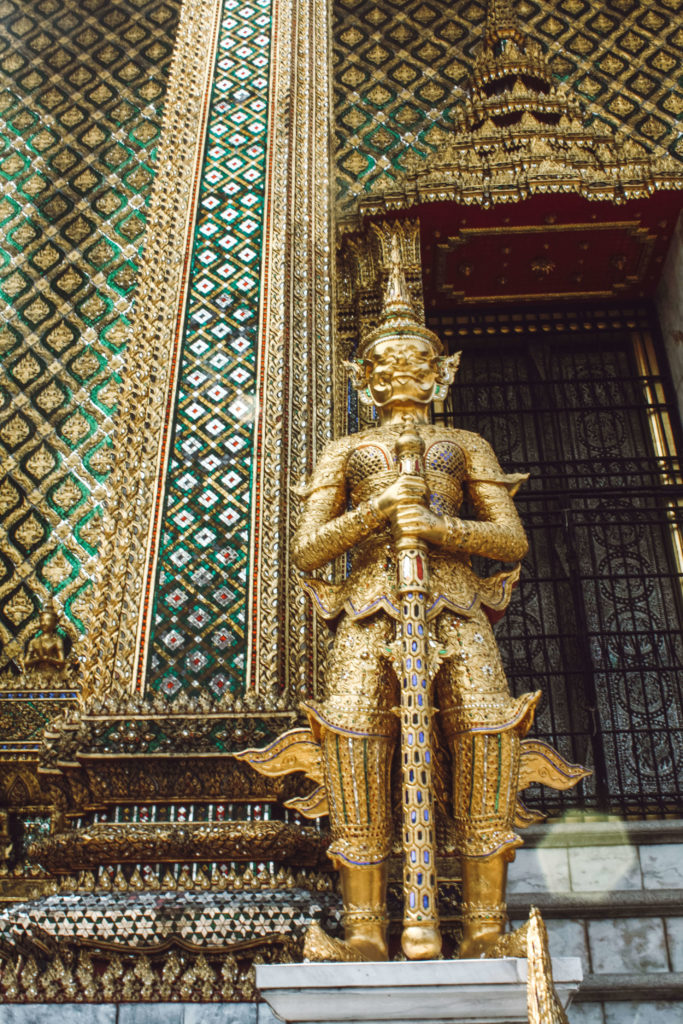 Golden figure in the Grand Palace, Bangkok Thailand