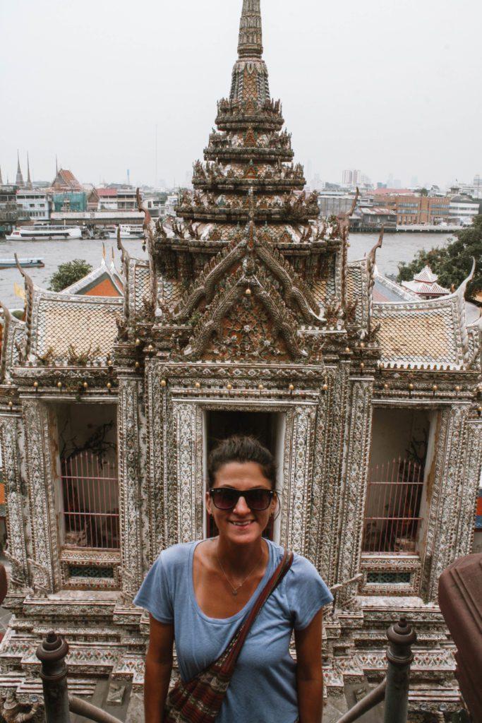 Woman smiling at Wat Arun Bangkok Thailand