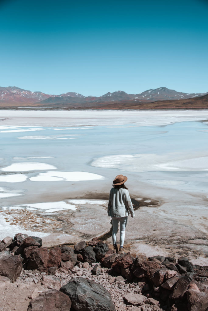 woman looking out at Salar de Talar in Atacama Desert