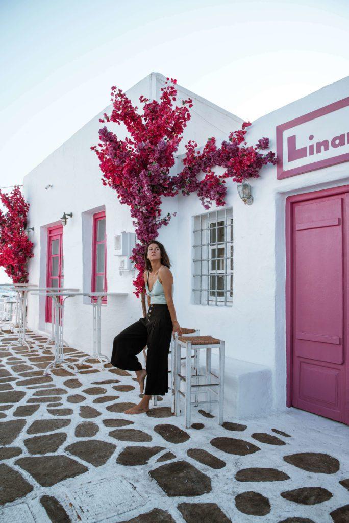 woman on a stool in Greek village