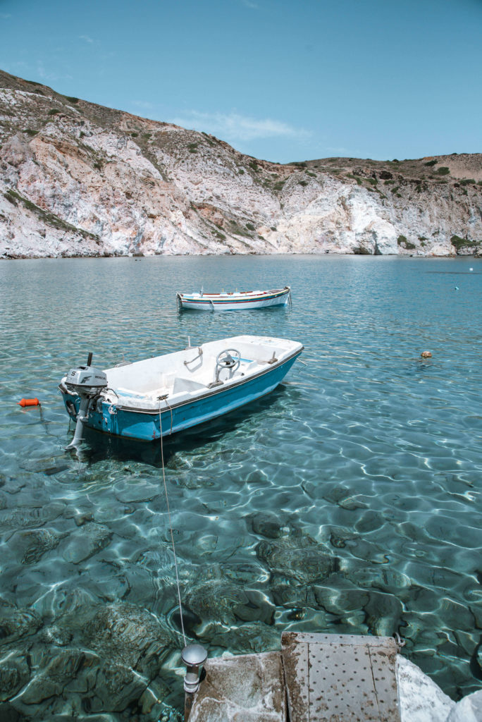 Boat in greece with clear blue water