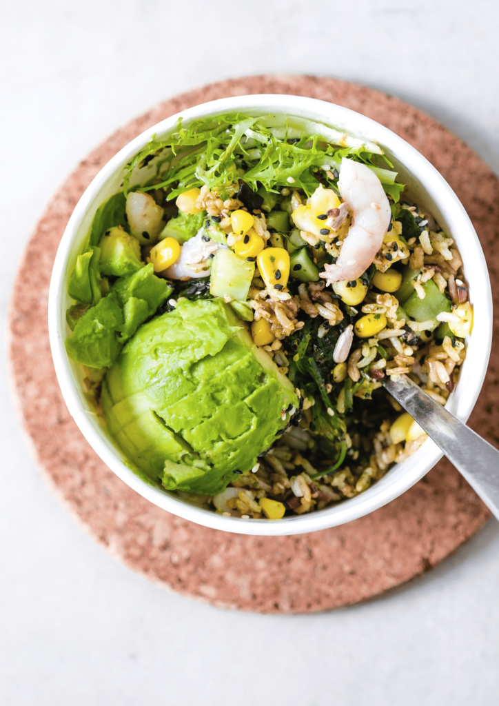 green salad with rice and avocado