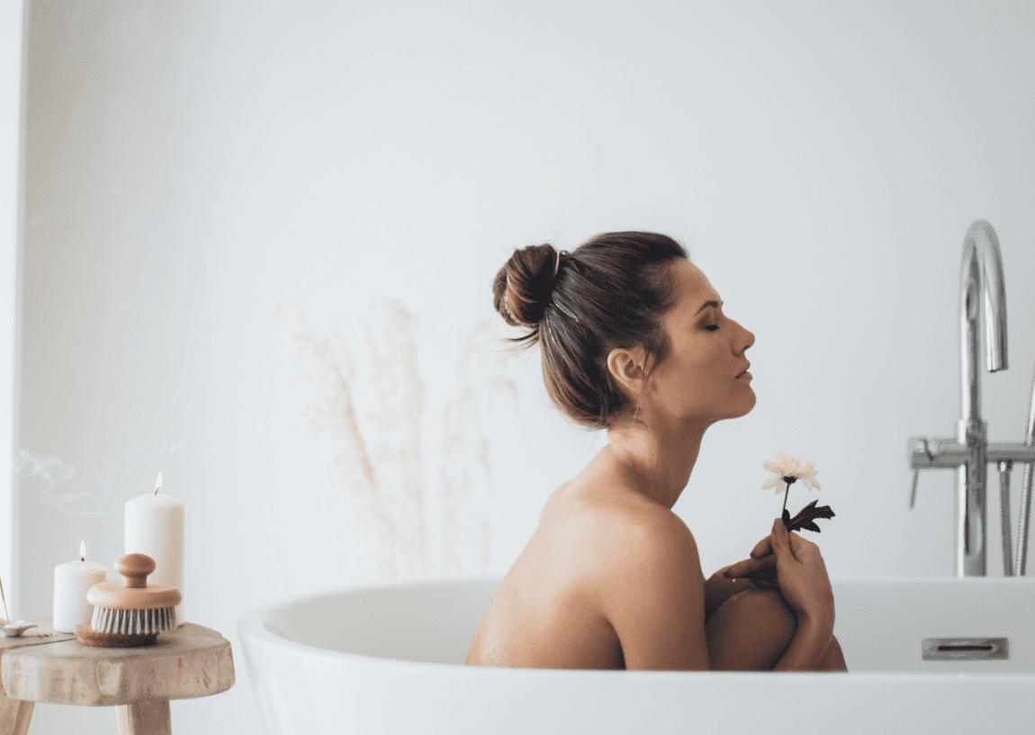 Winter self care rituals woman in bath