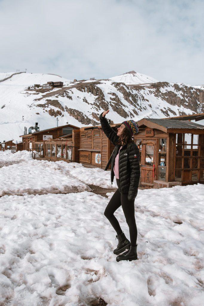 woman in the snow talking a winter walk