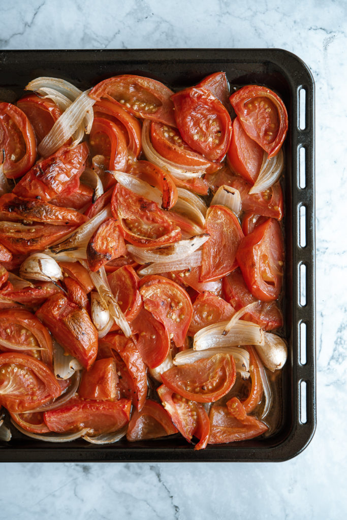 Tomatoes roasting vegan red pepper and tomato soup