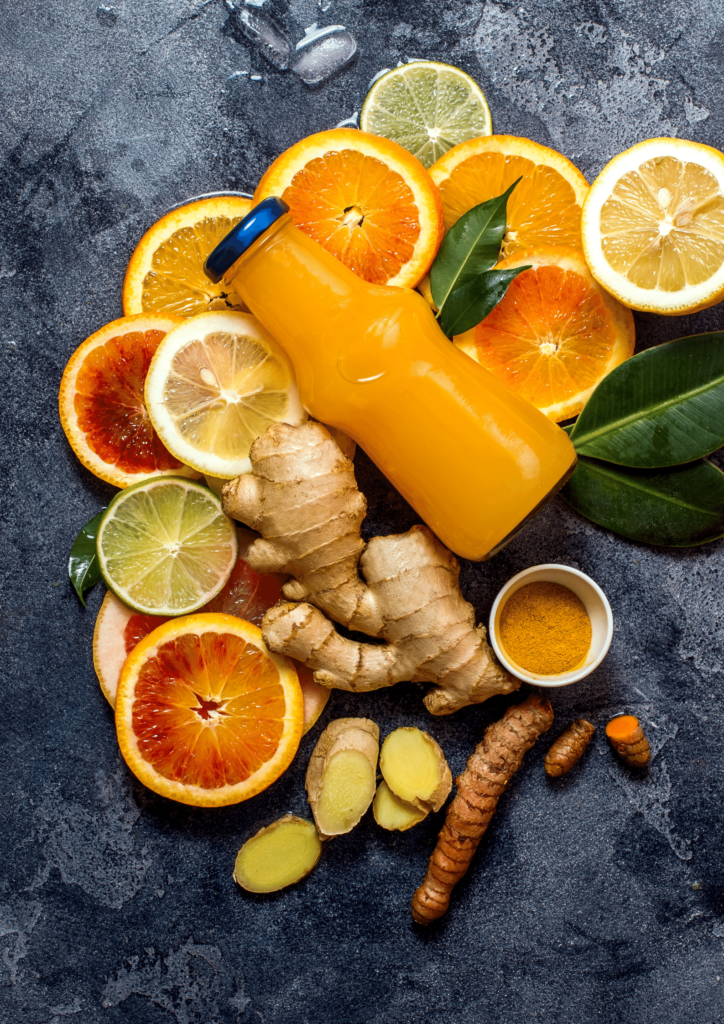 orange, ginger, turmeric shot flatlay