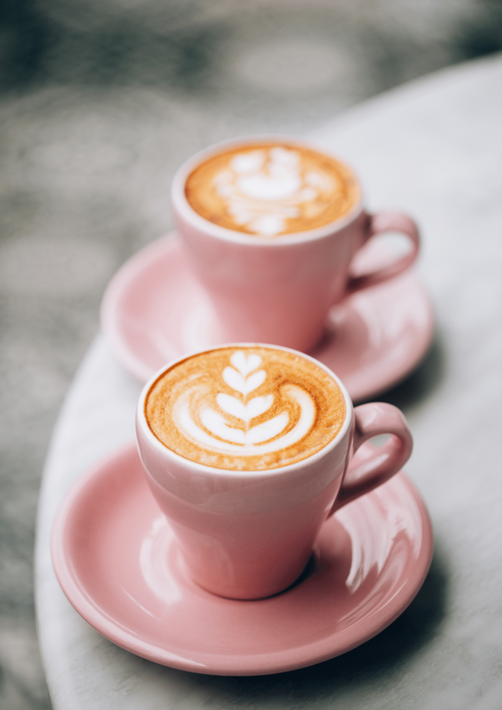 two pink cups of coffee to boost energy