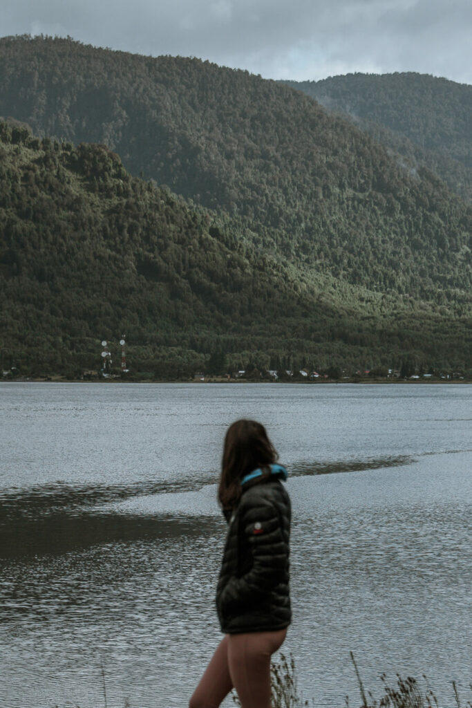 woman standing in front of lake on Carretera Austral itinerary