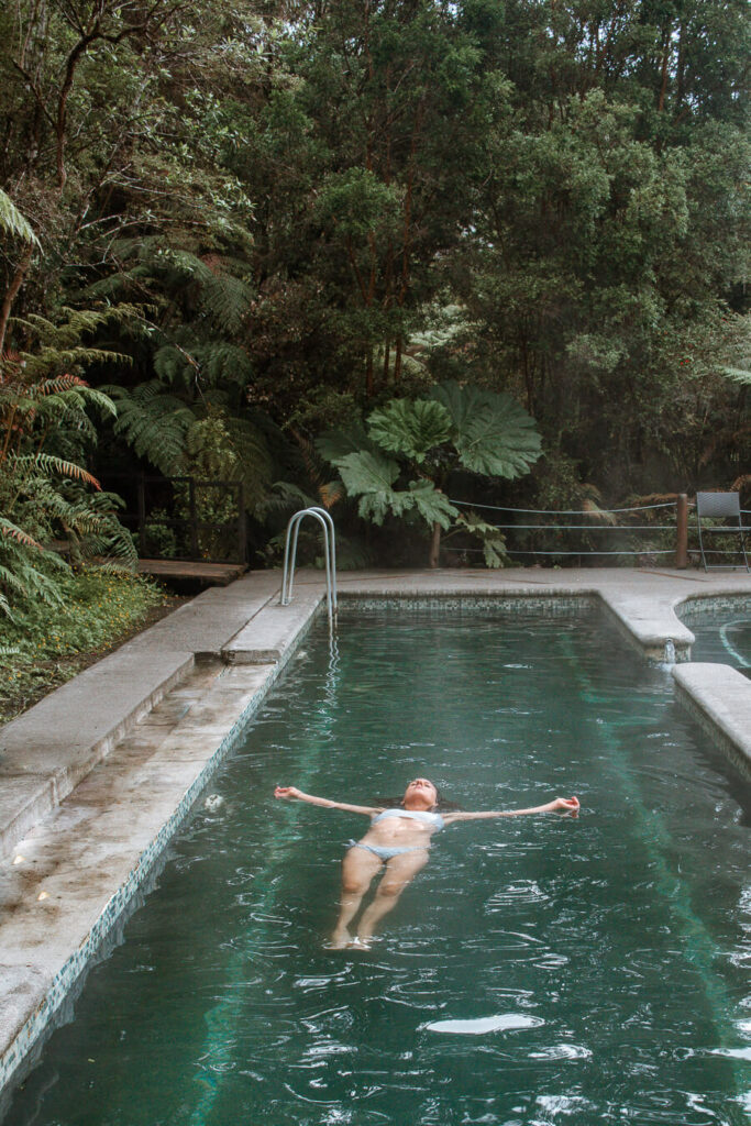 Puyuhuapi lodge and spa woman floating in a pool