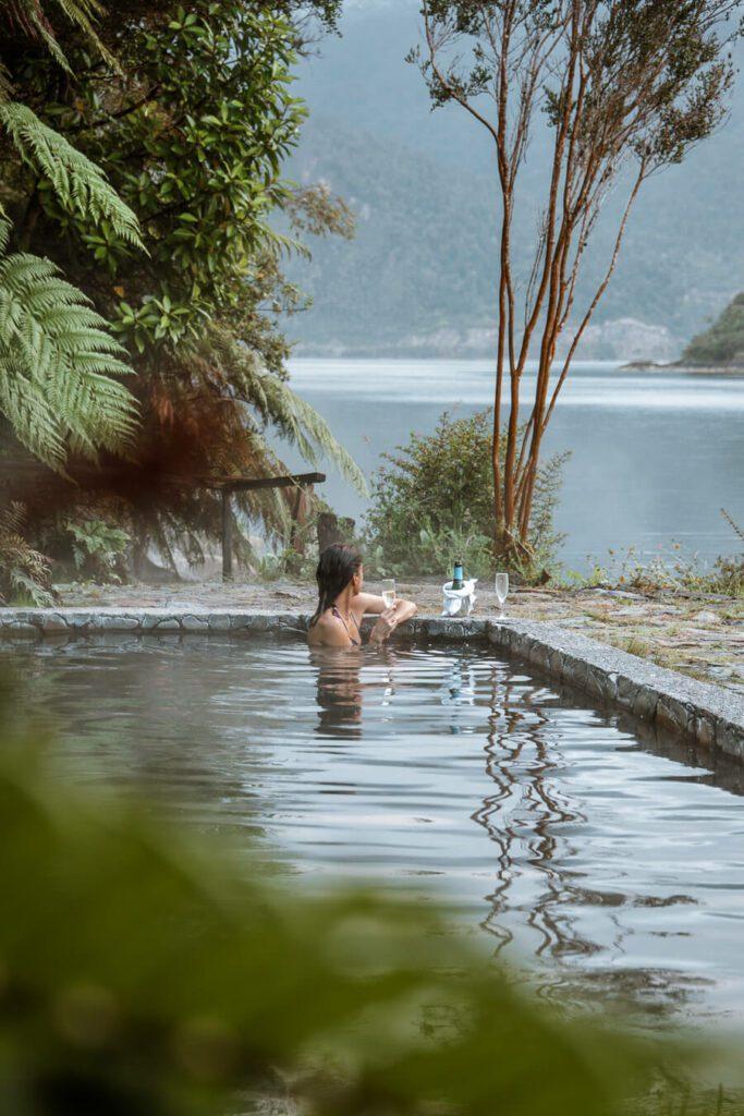 woman drinking champagne at a thermal spa at Puyuhuapi Lodge