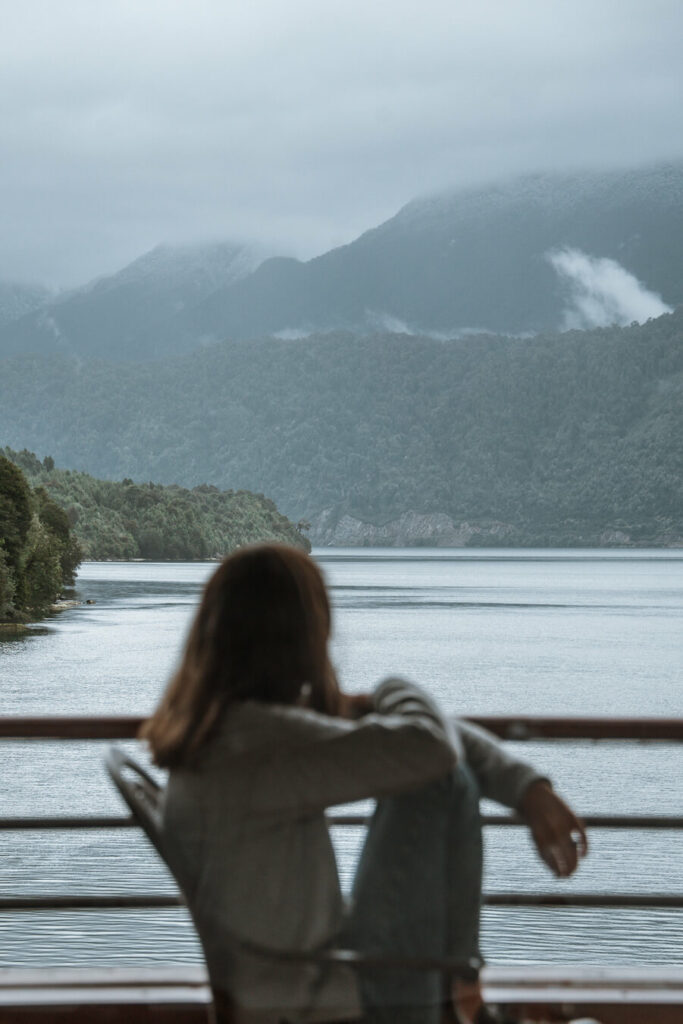 Woman looking out at view in Carretera Austral Chile