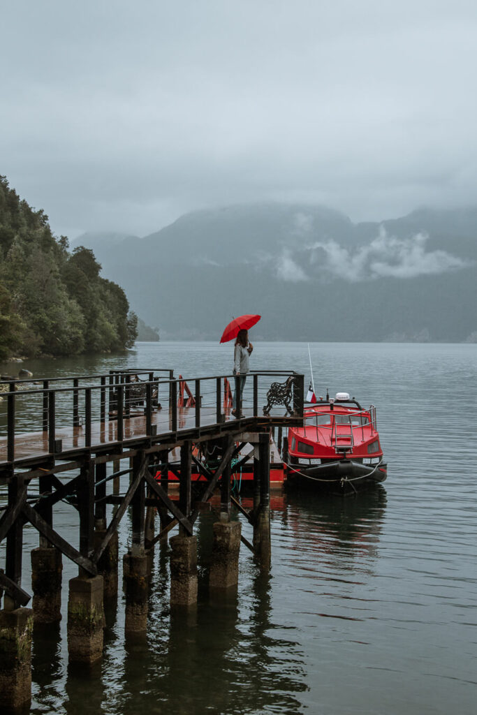 woman standing on pier at Puyuhuapi lodge and Spa