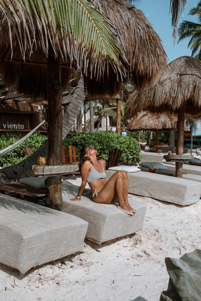 Woman at a beach club in Tulum where to stay in Tulum