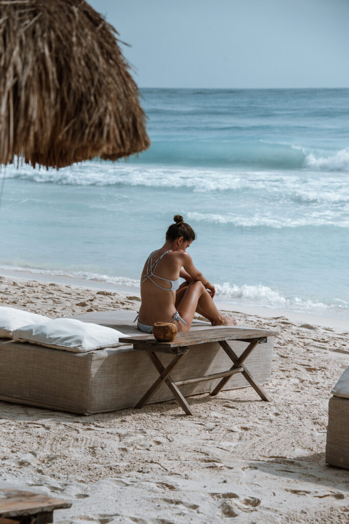 Woman at a beach club in Tulum Mexico