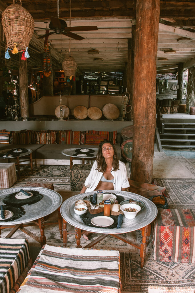 woman having lunch at restaurant in Tulum