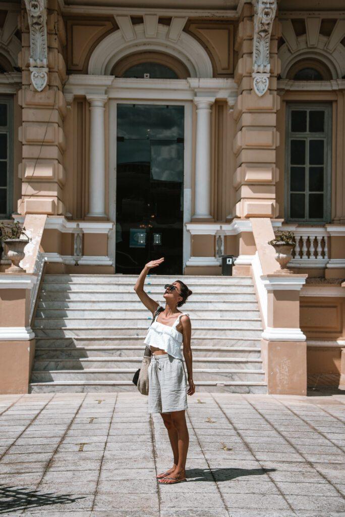 woman outside the Palacio Canton, Merida