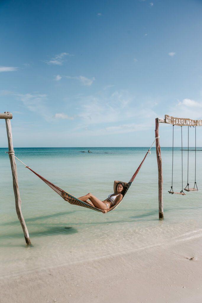 woman loungin gon a hammock in Holbox island