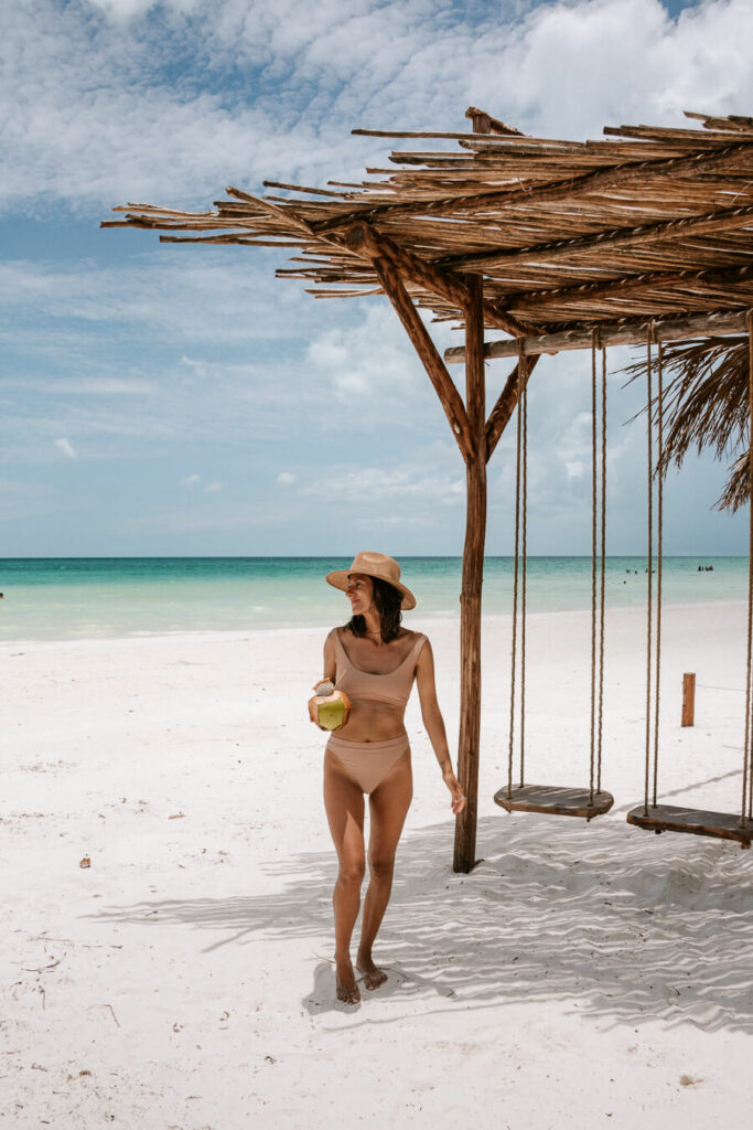 woman holding coconut on Holbox island