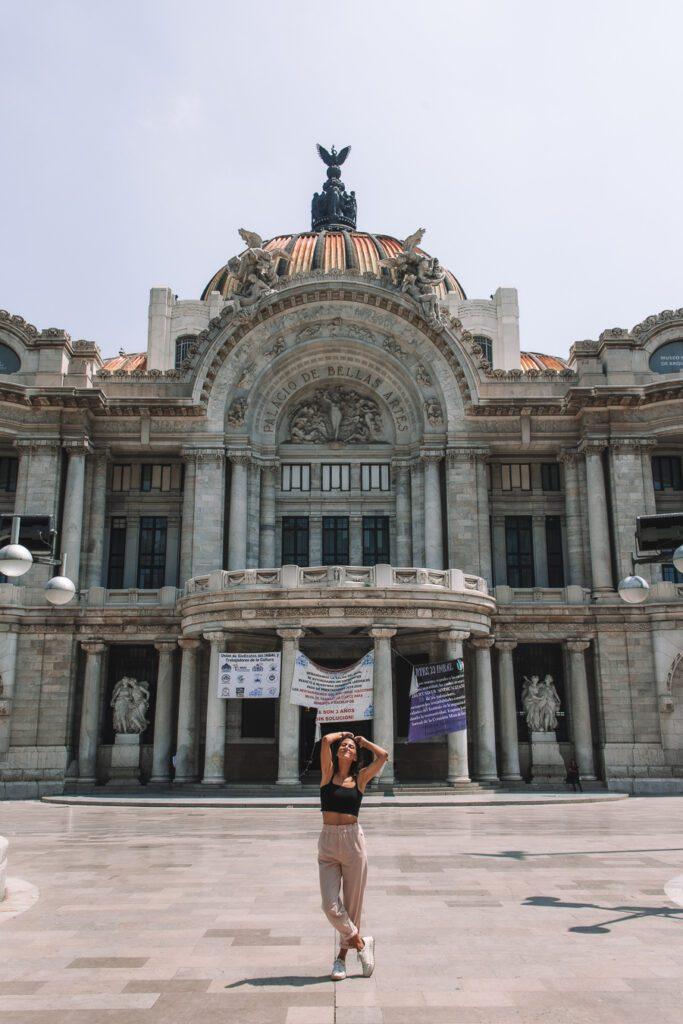 Woman in front of Palacio de bellas artes Mexico City