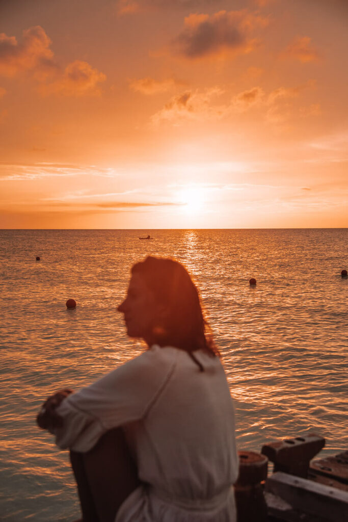 woman watching sunset in Holbox island