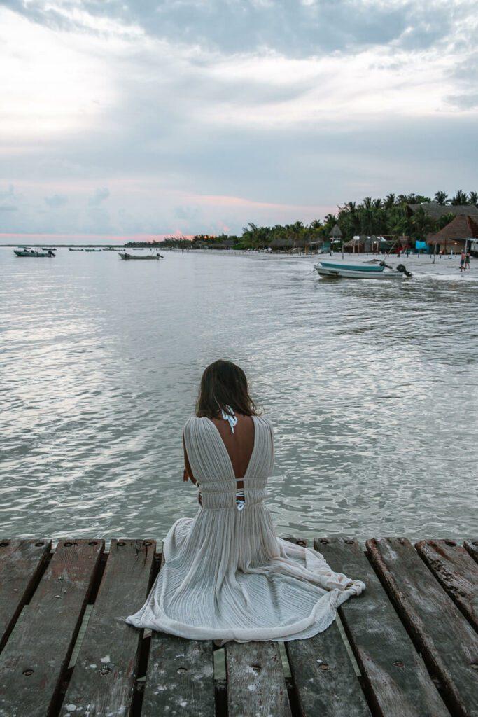 woman on pier on holbox island