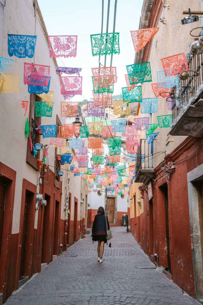 woman walking down a street in Guanajuato Mexico