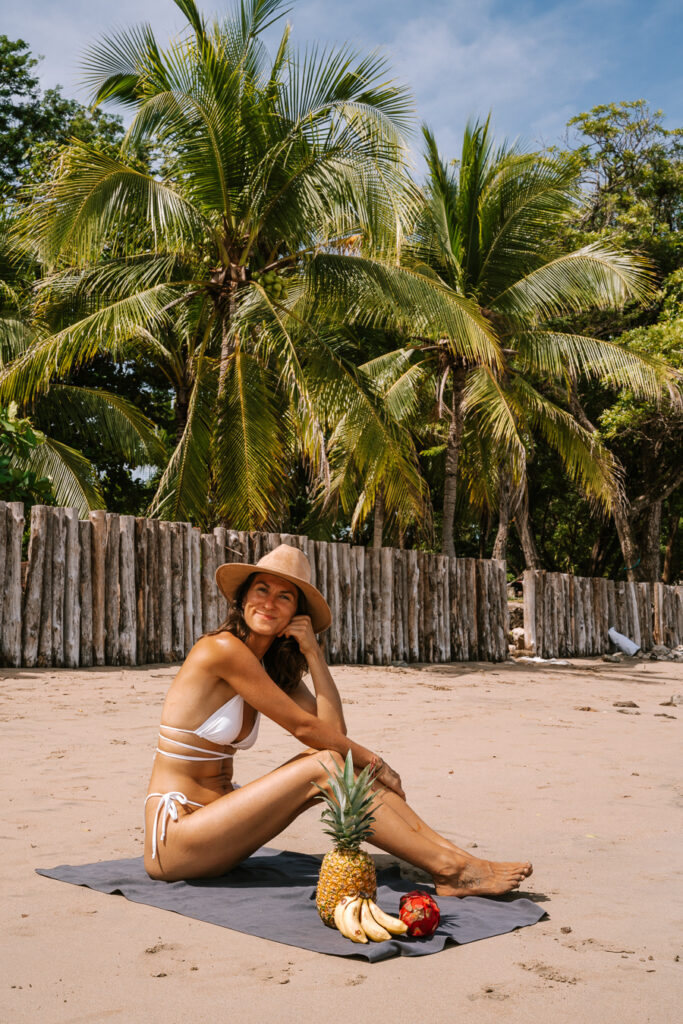 woman with fresh fruit on the beach in Nosara Costa Rica