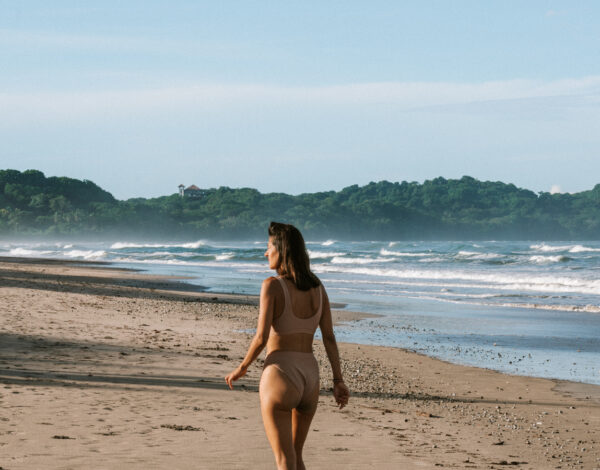 woman on the beach in Nosara Costa Rica