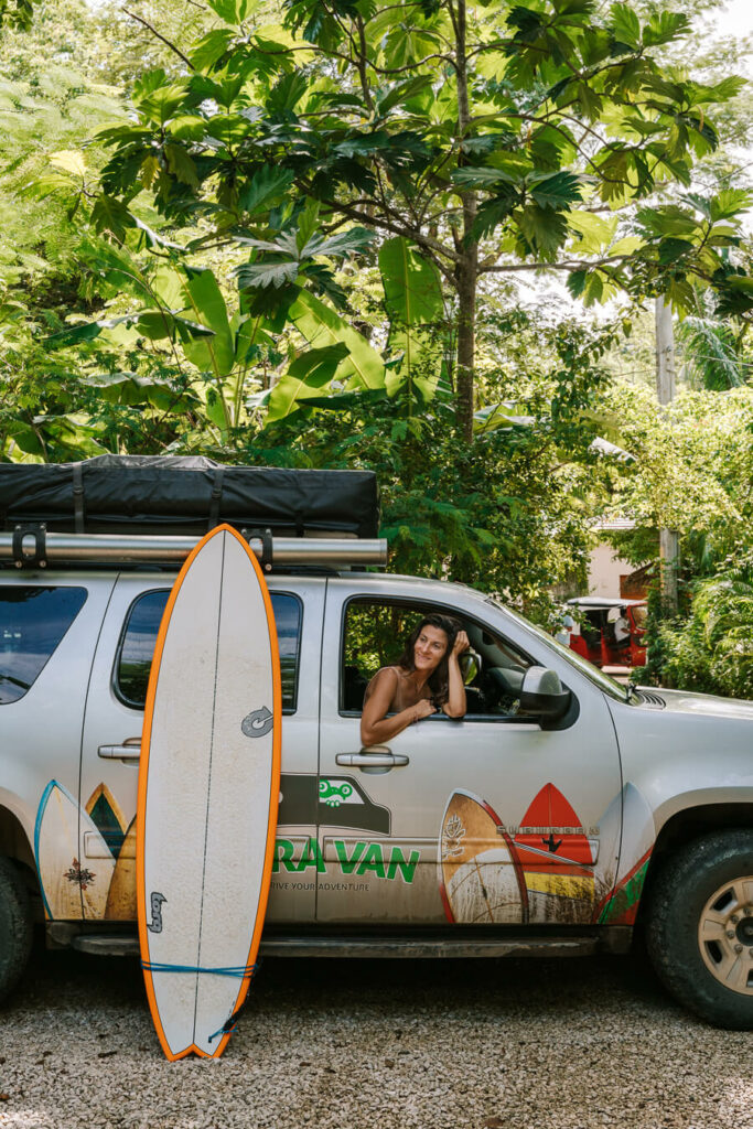 woman in car ready to go surfing